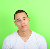 Portrait of tired man against green background Royalty Free Stock Photography
