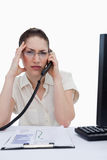 Portrait of a tired manager making a phone call while looking at Stock Images
