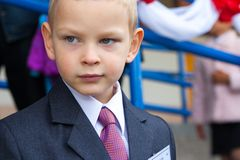 Portrait of a tired schoolboy. In the school yard Stock Photo