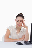 Portrait of a tired secretary using a computer Royalty Free Stock Photos