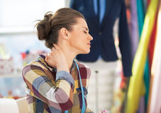 Portrait of tired tailor woman with neck pain Royalty Free Stock Photography
