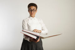 Portrait of a tired teacher with binders Royalty Free Stock Images