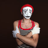 Portrait of a tired thoughtful mime. On a black background Stock Images