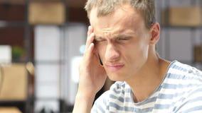 Portrait of Tired, Upset, Depressed Man, Headache at Work. Talented Man, Creative Designer, freelancer, employee, worker stock video footage