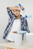 Portrait of tired woman painting new house Royalty Free Stock Photo