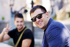 Portrait of to beautiful young men smiling on the street. Portrait of beautiful young men smiling outdoor stock photos