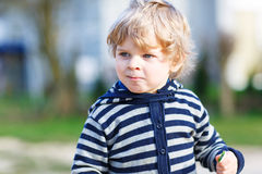 Portrait of toddler boy having fun on outdoor playground Royalty Free Stock Photo