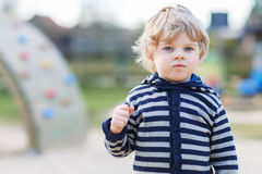 Portrait of toddler boy having fun on outdoor playground Royalty Free Stock Photography