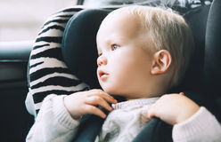 Portrait of toddler boy sitting in car seat. royalty free stock photo