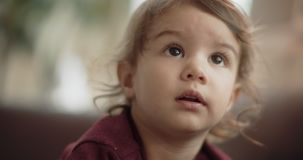 Portrait of a toddler on the couch. Shot in 4K RAW on a cinema camera stock footage