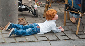 Portrait of a toddler crawling on the street. BREDA, NETHERLANDS – SEPTEMBER 4, 2011 : Redhead Day for young and old in the Dutch city of Breda. Thousands of Stock Photos