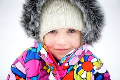 Portrait of toddler girl in colorful snowsuit Royalty Free Stock Image