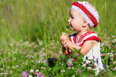 Portrait of toddler girl in meadow Royalty Free Stock Photo