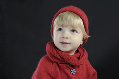 Portrait of a toddler with knitted hat on black Stock Photo