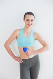 Portrait of toned woman with water bottle against wall royalty free stock photo