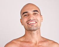 Portrait of a topless man smiling. Royalty Free Stock Image