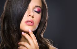 Portrait of touching face woman with brilliant make-up Royalty Free Stock Photography