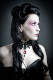 Portrait of a tough gothic woman. In corset Royalty Free Stock Photos