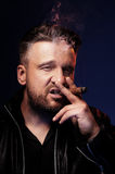 Portrait of a tough guy smoking cigar Royalty Free Stock Photography