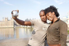 Portrait of tourist couple on Westminster. Stock Images