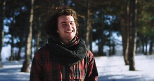 Portrait of a tourist in front of the camera enjoying the time while traveling alone very charismatic feeling excited in. A winter day stock footage