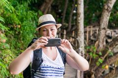 portrait of a tourist in a hat with a phone Royalty Free Stock Photo