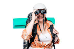 Portrait of a tourist looking at you through the binoculars Stock Image