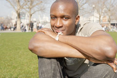 Portrait of tourist man in London park. Royalty Free Stock Photos