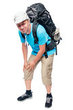 Portrait of a tourist man with a sick knee against a white. Background Royalty Free Stock Photography