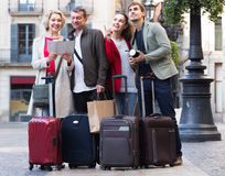 Portrait of tourists with map and baggage seeing the sights in E Royalty Free Stock Photography