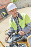 Portrait tractor operator at construction site Stock Images