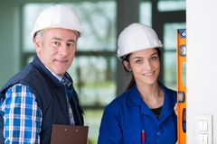 Portrait tradesman with female apprentice Royalty Free Stock Photography