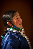 Portrait of a Traditional dressed lady from Tibet Stock Photo