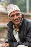 Portrait of a traditional elderly man smiling to the camera in K Royalty Free Stock Image