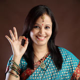 Portrait of traditional woman making OK sign Stock Photography