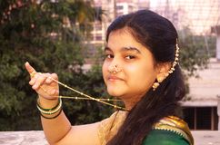 Traditional Maharashtrian Girl-7. A portrait of a traditionally dressed Indian teenager flaunting golden chain Royalty Free Stock Image