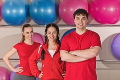 Portrait of trainers. Happy group of fit people at the gym stock images
