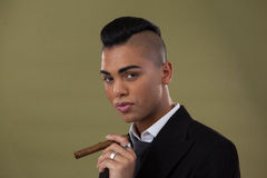 Portrait of transgender woman holding cigarette Stock Photos