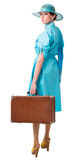 Portrait of a traveler in a retro style. Traveling woman in retro clothing. Isolation on white background Stock Image