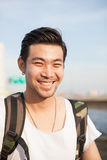 Portrait of traveling with backpacker asian man toothy smiling f Stock Image