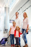 Portrait of traveling family in airport Stock Photos