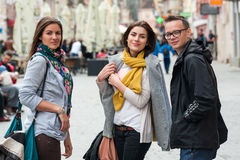 Portrait of traveling friends on shopping street Royalty Free Stock Photos