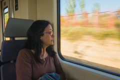 Portrait of traveling woman in train Royalty Free Stock Photos