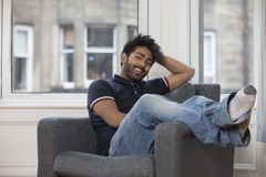 Portrait of a trendy Asian man at home. Royalty Free Stock Images