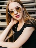 Young woman in black wear and sunglasses outdoors royalty free stock photos