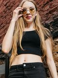 Young woman in black wear and sunglasses outdoors royalty free stock image