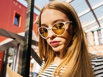 Young woman in black wear and sunglasses outdoors stock photography