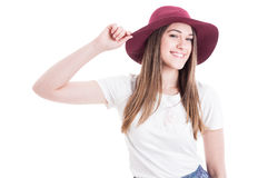 Portrait of trendy happy female with big hat smiling Stock Photography