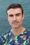 Portrait of a trendy man with a mustache Royalty Free Stock Photo