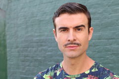 Portrait of a trendy man with a mustache Royalty Free Stock Photography